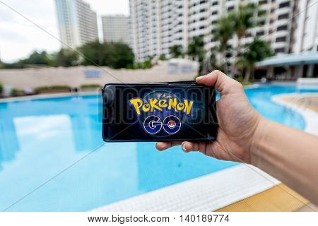 California, United States - July 16 2016 : Hand holding a cellphone to play Pokemon Go with blur background