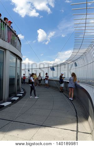 MUNICH GERMANY - AUGUST 4 2015: Unidentified people are enjoying a great view of Munich from the 291 m high Olympic tower (Olympiaturm) in the Olympic Park.