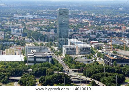 MUNICH GERMANY - AUGUST 4 2015: The Munich Uptown Building 146 m and 38- storey high tower the tallest skyscraper in the city. It is bought by the Government of Singapore and hired by O2.