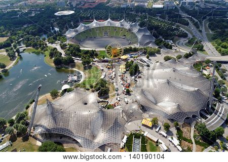 MUNICH GERMANY - AUGUST 4 2015: Aerial view of the Stadium and the Olympic Park constructed for the 1972 Summer Olympics seen from the 291 m high Olympic tower (Olympiaturm).