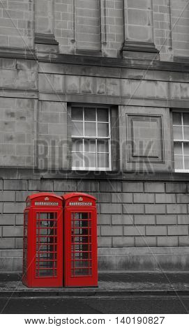 Two British Phone Booths on Royal Mile street in Edinburgh, Scotland