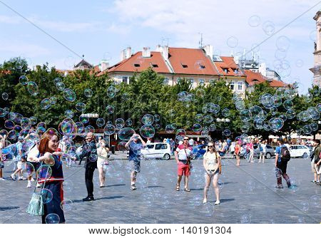 PRAGUE, CZECH REPUBLIC - JUNE 25, 2016: Holiday soap bubbles in the street in Prague