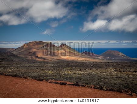 Volcanic landscape of the Timanfaya National Park ( also called The Montanas del Fuego or Mountains of Fire ) in Lanzarote, Canary Islands, Spain