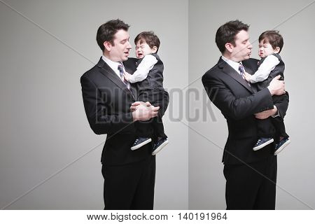 American father holding his Crying baby Boy