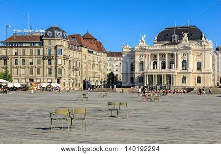 Zurich, Switzerland - 20 July, 2016: people and buildings on Sechselautenplatz square. Sechselautenplatz is a town square the largest one within the city of Zurich, it takes its name from the Sechselauten - the city's traditional spring holiday.