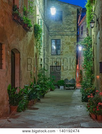 Street in the Tuscany village of Pienza, Italy at night.