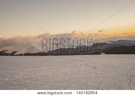 Winter Sunset In Carpathians Mountains Covered By Snow Retezat Romania