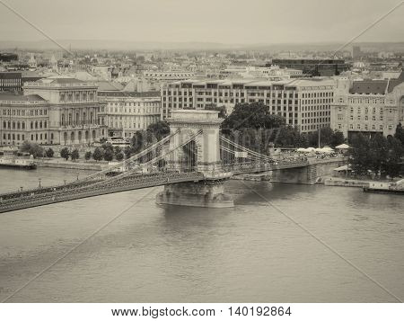 Szechenyi Chain Bridge Is A Suspension Bridge That Spans The River Danube Between Buda And Pest The Western And Eastern Sides Of Budapest The Capital Of Hungary Black And White Filter