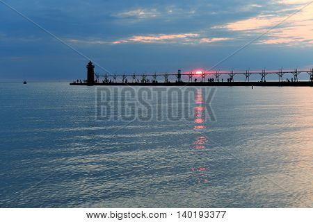 Lighthouse and pier in South Haven Michigan at sunset