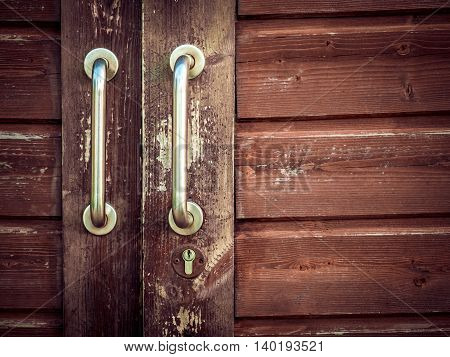 Old barn weathered wooden doors handle detail