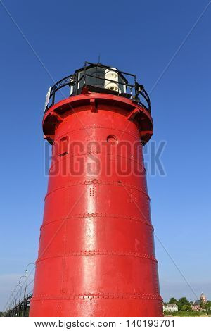 Red lighthouse in South Haven Michigan during daytime