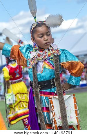 Coeur d'Alene Idaho USA - 07-23-2016. Young dancer at powwow. Young dancer participates in the Julyamsh Powwow on July 23 2016 at the Kootenai County Fairgrounds in Coeur d'Alene Idaho.