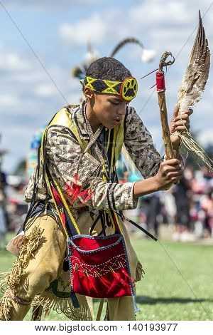 Coeur d'Alene Idaho USA - 07-23-2016. Native American powwow dance competitor. Young dancer participates in the Julyamsh Powwow on July 23 2016 at the Kootenai County Fairgrounds in Coeur d'Alene Idaho.