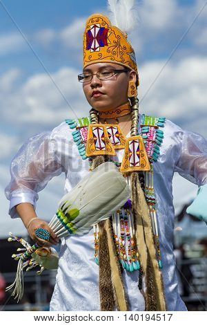 Coeur d'Alene Idaho USA - 07-23-2016. Regal looking native American woman. Young dancer participates in the Julyamsh Powwow on July 23 2016 at the Kootenai County Fairgrounds in Coeur d'Alene Idaho.
