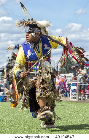 Coeur d'Alene Idaho USA - 07-23-2016. Man in competition powwow dance. Young dancer participates in the Julyamsh Powwow on July 23 2016 at the Kootenai County Fairgrounds in Coeur d'Alene Idaho.