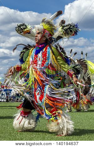 Coeur d'Alene Idaho USA - 07-23-2016. Native American man dancing at powwow. Young dancer participates in the Julyamsh Powwow on July 23 2016 at the Kootenai County Fairgrounds in Coeur d'Alene Idaho.