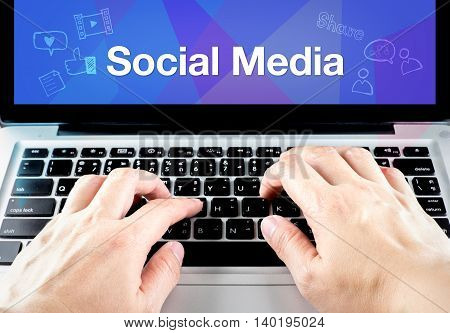 Hand Type On Laptop With Social Media On Screen With Blur Blue Background,social Business Concept