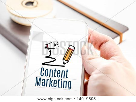 Close Up Hand Holding Smartphone With Content Marketing Word And Pencil And Speaker Icon, Digital Ma