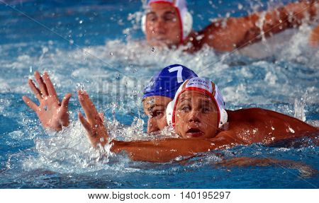 Budapest Hungary - Jul 14 2014. Balazs Sziranyi (ESP 7) and Adam Decker (HUN 7) fighting for the ball.The Waterpolo European Championship was held in Alfred Hajos Swimming Centre in 2014.