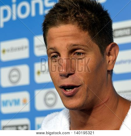 Budapest Hungary - Jul 14 2014. Balazs Sziranyi (ESP) talking after Spain-Hungary preliminary match. The Waterpolo European Championship was held in Alfred Hajos Swimming Centre in 2014.