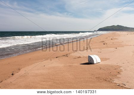 Styrofoam floats for fishing nets thrown on the sea shore.