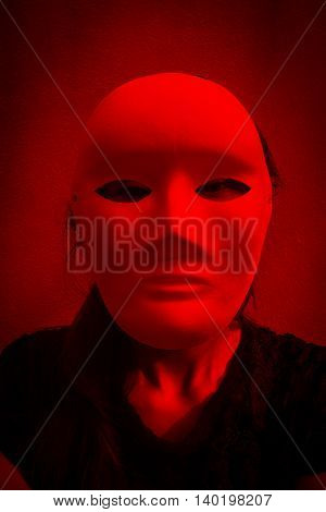Mysterious woman in black dress wearing white mask,Scary background for halloween