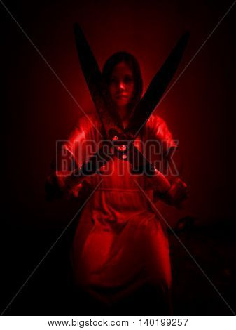 Horror scene of woman with grass shears,Serial killer or violence concept background
