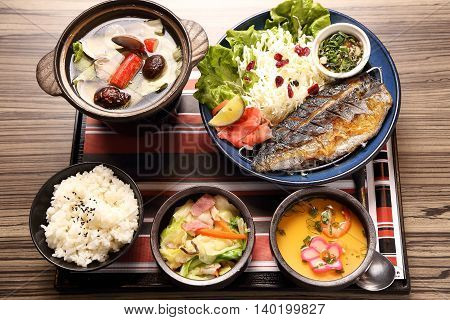 Japanese tray meal with fried fish rice and soup in asian restaurant