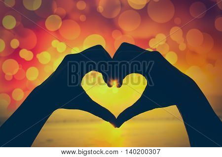 Valentine Background. Silhouette Of Human Hand In Heart Shape Showing Love Friendship.