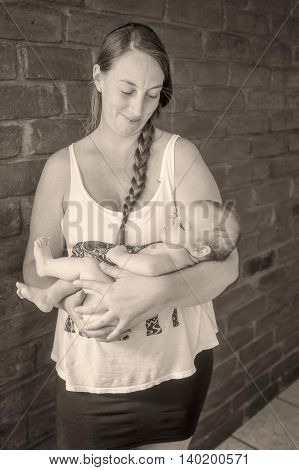 Young Blonde Mother Holding His Newborn Baby Boy Monochrome Shoot