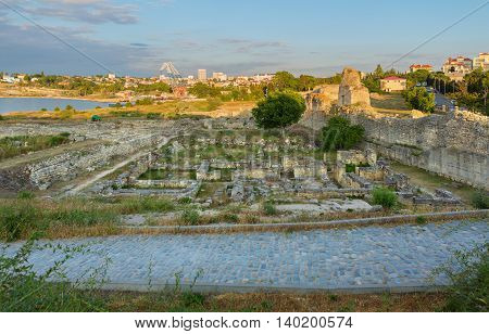 Ancient ruins in Chersonesus Taurica in the rays of setting sun. Sevastopol, Crimea. Russia