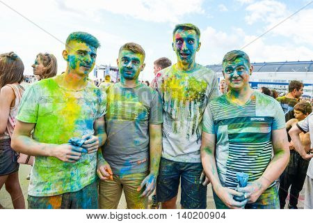 Khabarovsk, Russia - June 25, 2016: Tourist with students celebrating Holi on 25 July 2016 in Khabarovsk, Russia. Holi is a spring festival celebrated as a festival of colors.