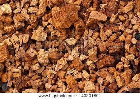 Background of chunks of wood decaying from brown cubical rot
