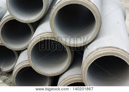 Downpipes cement sewers street drainage construction stacl