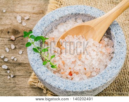 Himalayan Pink Salt In Mortar With Thyme On Hemp Sack Background. Himalayan Salt Commonly Used In Co