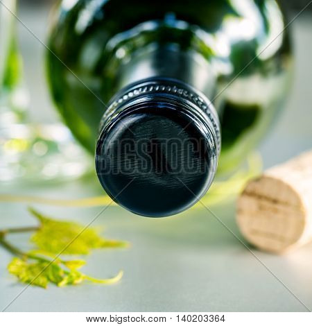 Wine Bottle With Vine And Wine Cork Put On The Board.close Up Wine Bottle With Grape Vine And Wine C