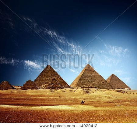 Giza valley with Great pyramids and blue sky with clouds