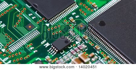 Green electronic board with components