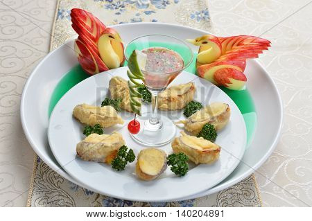 Fried wanton with cocktail and duck apple on white plate in restaurant