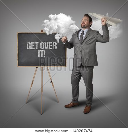 Get over it text on blackboard with businessman and paper plane