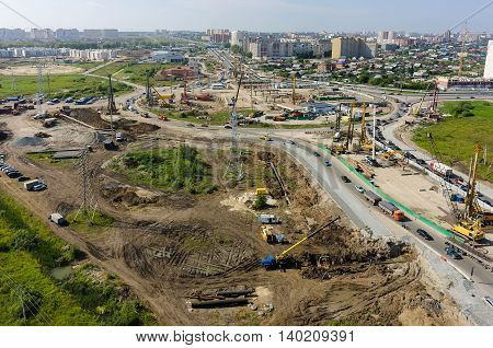 Tyumen, Russia - July 27, 2016: Construction of two-level outcome on bypass road on Fedyuninskogo and Melnikayte streets intersection