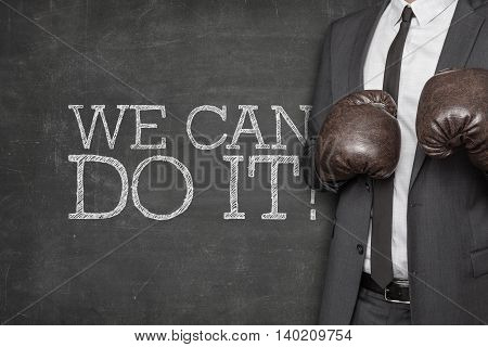 We can do it on blackboard with businessman wearing boxing gloves