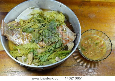 steam fish and vegetable dipping with soy bean sauce