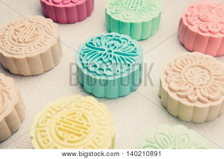 Traditional mooncakes on table.  Snowy skin mooncakes. Chinese mid autumn festival foods.
