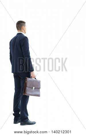 Business man holding a briefcase
