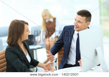 Business partners discussing n meeting hall
