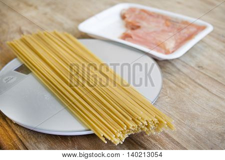 preparing wholemeal spaghetti with smoked salmon and tomato sauce
