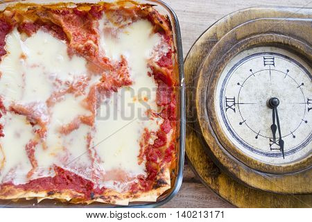 time of brunch with a glass bowl of lasagne
