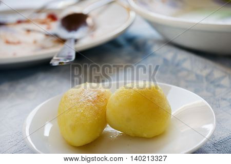 crispy fried new potatoes in a white dish