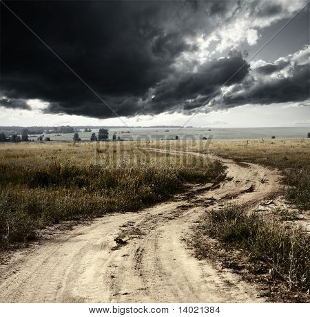 Rural road and storm clouds